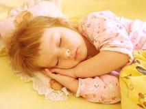 Das Kind im Bett Stockbild