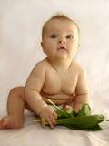Das Kind isst Brei Stockbild