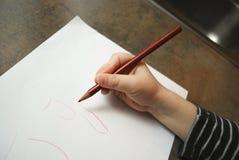 Das Kind lernt zu schreiben Lizenzfreies Stockfoto