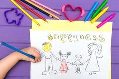 Das Kind malt eine Skizze der Familie Lizenzfreie Stockfotografie