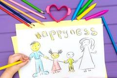 Das Kind malt eine Skizze der Familie Lizenzfreie Stockbilder
