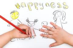 Das Kind malt eine Skizze der Familie Stockfotografie