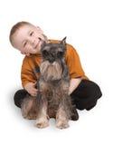Das Kind mit einem Hund Stockfoto