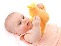 Das Kind mit einem Spielzeug. Stockbilder