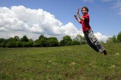 Das Kindspringen lizenzfreies stockfoto