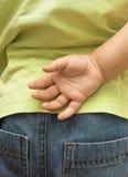 Das Kindverstecken ist Hand Stockbild