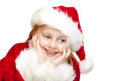Das kleine Mädchen, das als Weihnachtsmann gekleidet wird, lächelt glücklich Lizenzfreies Stockbild