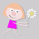 Das kleine Mädchen mit einer Kamille Stockfoto