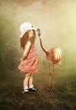Das kleine Mädchen und die Flamingos Stockfotos