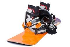 Das komplette Set der Ausrüstung für Snowboarding Lizenzfreie Stockfotos