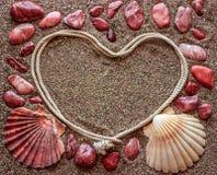 Das Konzept der Liebe Um den Rahmen in Form eines Herzens AR Lizenzfreie Stockfotografie