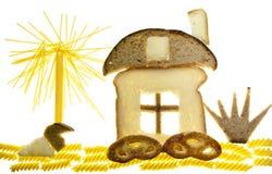 Das Konzept des süßen Hauses vom Brot und von den Teigwaren Stockfoto