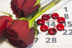 Das Konzept von Feiertagen mit einem Kalender Lizenzfreie Stockbilder