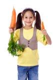 Lächelndes Mädchen mit zwei Karotten Stockfoto