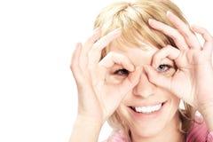 Das lächelnde Mädchen in den Gläsern Stockbilder