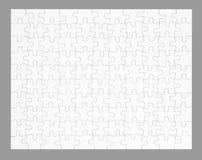 Das leere Puzzlespiel getrennt auf Grau Lizenzfreie Stockfotos