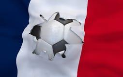 Das Loch in der Flagge von Frankreich und von Fußball Stockbild