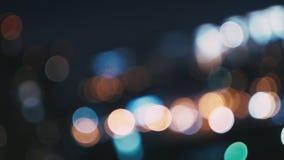 Das luzes fundo Defocused do borrão da cidade ainda filme