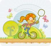 Das Mädchen auf einem Fahrrad Stockfoto