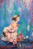 Das Mädchen, das eine Abbildung zeichnet Stockfotos