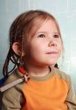 Das Mädchen das gekräuselte Haar Stockbilder