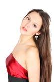 Das Mädchen, das rotes Kleid trägt, betrachtet Kamera Lizenzfreie Stockbilder