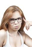 Das Mädchen in den Gläsern. Lizenzfreie Stockfotos