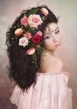 Das Mädchen in den Rosen Lizenzfreie Stockfotos