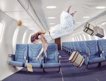 Das Mädchen in einem Flugzeug Stockbilder