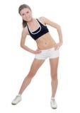 Das Mädchen in einem Haltungsyoga Stockfoto