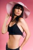 Das Mädchen in einem Hut stockfotos