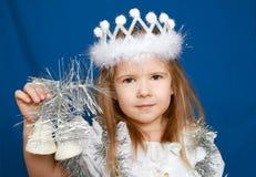 Das Mädchen in einem Kleid des neuen Jahres Stockfotografie
