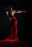 Das Mädchen in einem roten Kleid Stockbilder