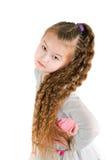Das Mädchen in einer grauen Klage Stockfoto