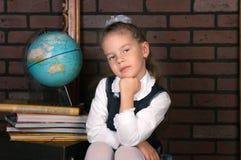 Das Mädchen in einer Schuluniform Lizenzfreies Stockbild