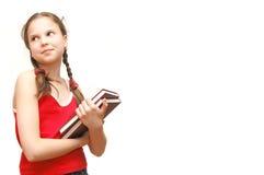 Das Mädchen im Rot hält Bücher an Lizenzfreie Stockfotos