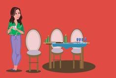 Das Mädchen machte ein festliches Abendessen Eine Umhüllungstabelle Lizenzfreie Stockfotos