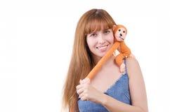 Das Mädchen mit dem Affelächeln Stockbild