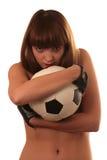 Das Mädchen mit einem Fußball stockbild