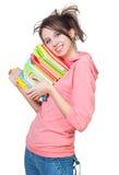 Das Mädchen mit einem Haufen der Bücher Stockfotos