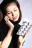 Das Mädchen mit einem Notizbuch. Stockfoto