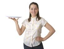 Das Mädchen mit einem Tellersegment Stockfoto