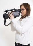 Das Mädchen mit einer Video Kamera Stockfotografie