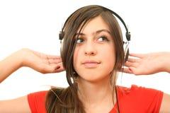 Das Mädchen mit Kopfhörern Stockbilder