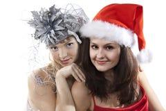 Das Mädchen mit zwei Freunden feiern neues Jahr. Lizenzfreies Stockbild