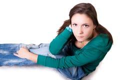 Das Mädchen sitzt Stockbild