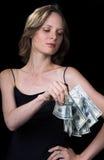 Das Mädchen und das Geld Stockfoto