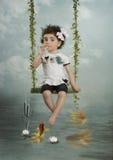 Das Mädchen und der Goldfisch Lizenzfreies Stockfoto