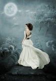 Das Mädchen und der Mond Stockfotografie