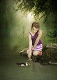 Das Mädchen und die Ente Stockfoto